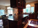 Large Cherry Island with a Granite Counter Top